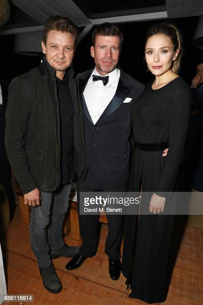 Jeremy Renner director Taylor Sheridan and Elizabeth Olsen attend The Weinstein Company party in celebration of 'Wind River' in association with de...