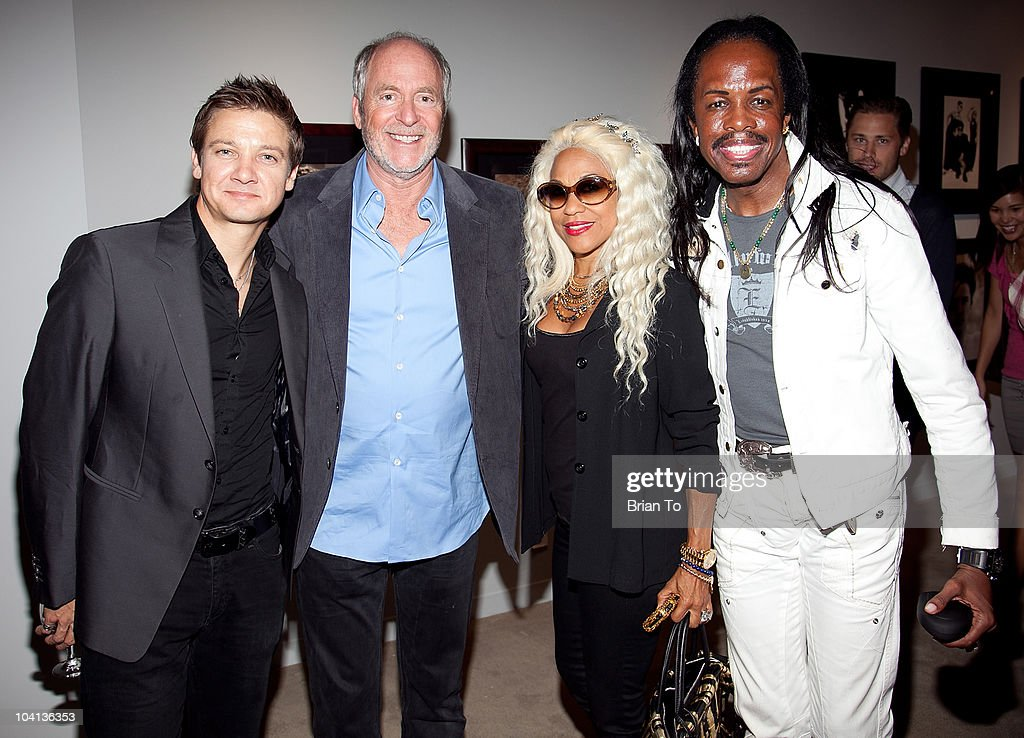 Jeremy Renner, Greg Gorman, Shelly Clark-White and Verdine White pose together at the opening night reception of 'Greg Gorman: A Distinctive Vision 1970-2010' at Pacific Design Center on September 15, 2010 in West Hollywood, California.