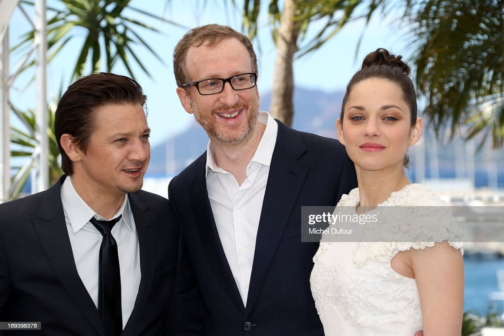 <a gi-track='captionPersonalityLinkClicked' href=/galleries/search?phrase=Jeremy+Renner&family=editorial&specificpeople=708701 ng-click='$event.stopPropagation()'>Jeremy Renner</a>, <a gi-track='captionPersonalityLinkClicked' href=/galleries/search?phrase=James+Gray&family=editorial&specificpeople=2479723 ng-click='$event.stopPropagation()'>James Gray</a> and <a gi-track='captionPersonalityLinkClicked' href=/galleries/search?phrase=Marion+Cotillard&family=editorial&specificpeople=215303 ng-click='$event.stopPropagation()'>Marion Cotillard</a> attend 'The Immigrant' photocall during The 66th Annual Cannes Film Festival at he Palais des Festivals on May 24, 2013 in Cannes, France.