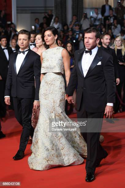 Jeremy Renner Nicole Sheridan and Director Taylor Sheridan attend the 'The Square' screening during the 70th annual Cannes Film Festival at Palais...