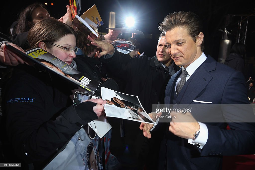 Jeremy Renner signs autographs as he attends the German premiere of 'Hansel and Gretel: Witch Hunters' at the Kulturbrauerei on February 12, 2013 in Berlin, Germany.