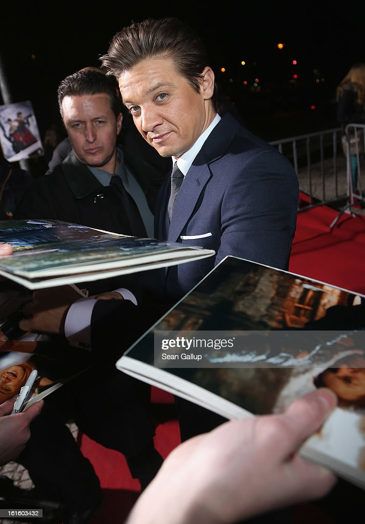 <a gi-track='captionPersonalityLinkClicked' href=/galleries/search?phrase=Jeremy+Renner&family=editorial&specificpeople=708701 ng-click='$event.stopPropagation()'>Jeremy Renner</a> signs autographs for fans as he attends the German premiere of 'Hansel and Gretel: Witch Hunters' at the Kulturbrauerei on February 12, 2013 in Berlin, Germany.