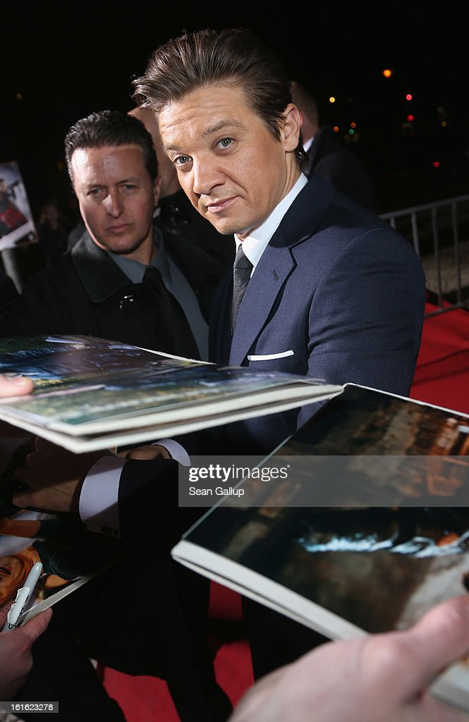 Jeremy Renner signs autographs for fans as he attends the German premiere of 'Hansel and Gretel: Witch Hunters' at the Kulturbrauerei on February 12, 2013 in Berlin, Germany.