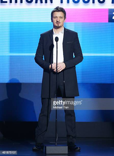 Jeremy Renner speaks onstage at the 2013 American Music Awards held at Nokia Theatre LA Live on November 24 2013 in Los Angeles California