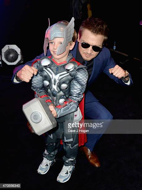 Jeremy Renner with Little Thor as he attends 'The Avengers Age Of Ultron' European premiere at Westfield London on April 21 2015 in London England