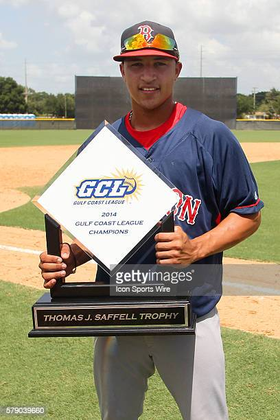 Jeremy Rivera of the Red Sox poses with the trophy after the Gulf Coast League Championship game between the GCL Red Sox and the GCL Yankees 1 at the...