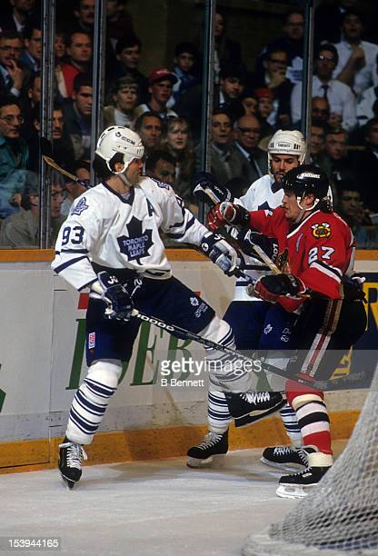 Jeremy Roenick of the Chicago Blackhawks checks Doug Gilmour of the Toronto Maple Leafs during their game on April 12 1994 at the Maple Leaf Gardens...