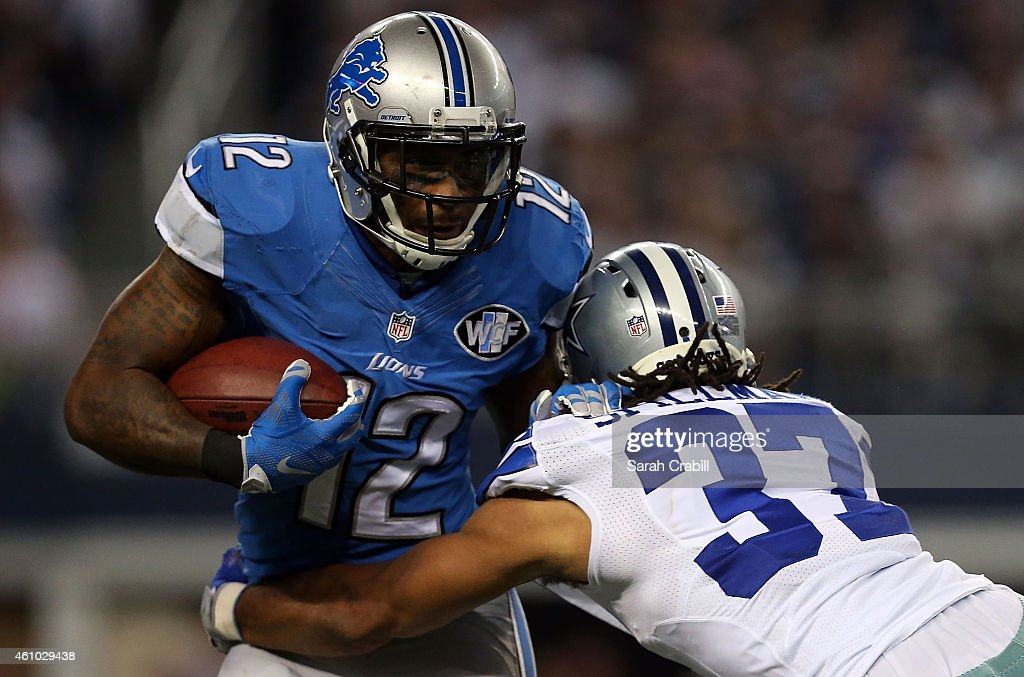 Jeremy Ross #12 of the Detroit Lions tries to break away from <a gi-track='captionPersonalityLinkClicked' href=/galleries/search?phrase=C.J.+Spillman&family=editorial&specificpeople=4650610 ng-click='$event.stopPropagation()'>C.J. Spillman</a> #37 of the Dallas Cowboys during the second half of their NFC Wild Card Playoff game at AT&T Stadium on January 4, 2015 in Arlington, Texas.