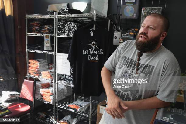 Jeremy Schumacher sells solar eclipse merchandise on August 18 2017 in Makanda Illinois With approximately 2 minutes 40 seconds of totality the town...