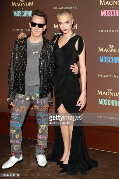 Jeremy Scott and Cara Delevingne attend Magnum party during the 70th annual Cannes Film Festival at Magnum Beach on May 18 2017 in Cannes France