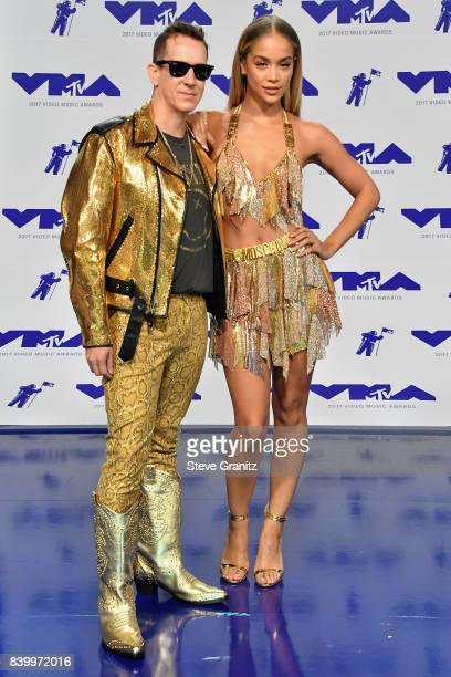 Jeremy Scott and Jasmine Sanders attend the 2017 MTV Video Music Awards at The Forum on August 27 2017 in Inglewood California