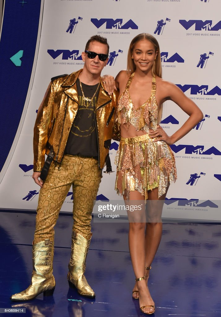 Jeremy Scott (L) and Jasmine Sanders attend the 2017 MTV Video Music Awards at The Forum on August 27, 2017 in Inglewood, California.