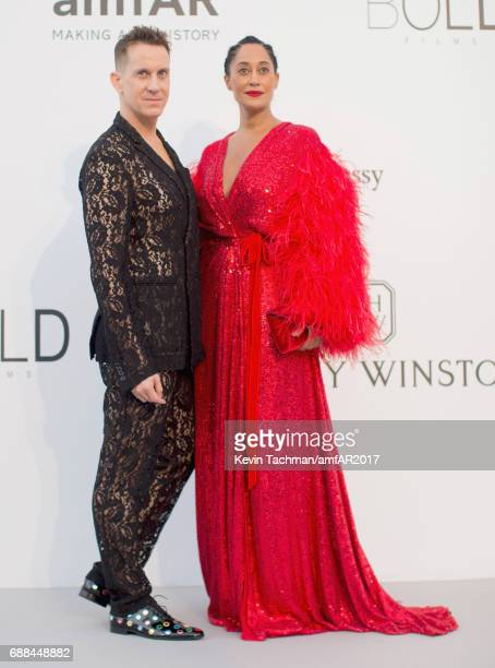 Jeremy Scott and Tracee Ellis Ross arrive at the amfAR Gala Cannes 2017 at Hotel du CapEdenRoc on May 25 2017 in Cap d'Antibes France