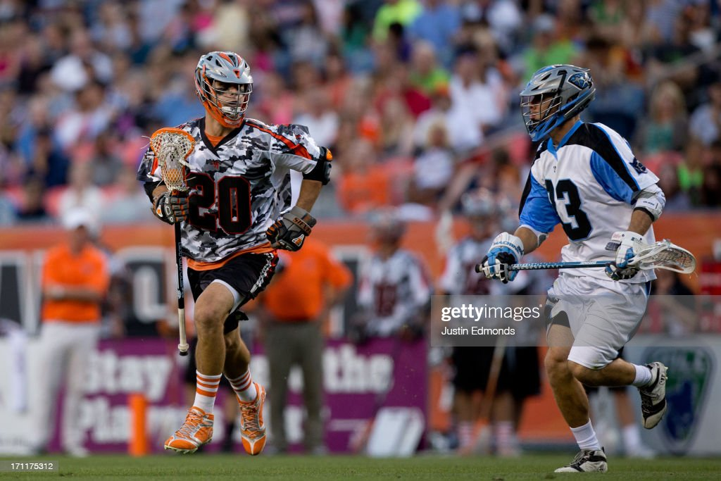 Jeremy Sieverts #20 of the Denver Outlaws drives to the net against Jake Bernhardt #33 of the Ohio Machine during the third quarter at Sports Authority Field at Mile High on June 22, 2013 in Denver, Colorado. The Outlaws defeated the Machine 19-5 to improve to 8-0 on the season.