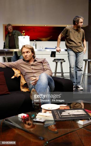 Jeremy Sims Steve Hilton and John Hannah appear on stage in 'Riflemind' by Andrew Upton during a photocall at the Trafalgar Studios in London's West...