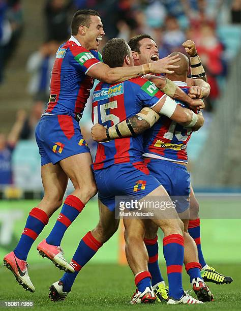 Jeremy Smith of the Knights celebrates with team mates Darius Boyd Danny Buderus and Chris Houston after scoring a try during the NRL Elimination...