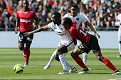 Jeremy Sorbon of Guingamp and JeanKevin Augustin of Paris SaintGermain during the French League 1 match between EA Guingamp and Paris SaintGermain on...