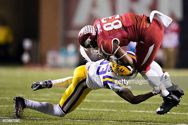 Jeremy Sprinkle of the Arkansas Razorbacks is tackled after catching a pass by Jamal Adams of the LSU Tigers at Razorback Stadium on November 12 2016...