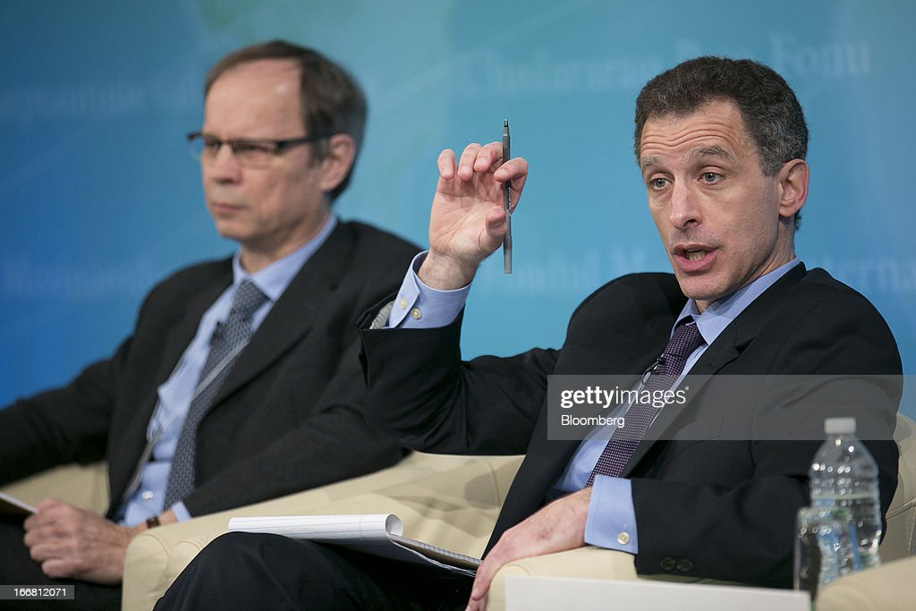 Jeremy Stein, governor of the U.S. Federal Reserve, right, speaks at a macro policy discussion during the International Monetary Fund (IMF) and World Bank Group Spring Meetings with Jean Tirole, professor at Massachusetts Institute of Technology (MIT), in Washington, D.C., U.S., on Wednesday, April 17, 2013. As much as 20 percent of non-bank corporate debt in the weakest euro-area economies is unsustainable and may force companies to cut dividends and sell assets, dealing further blows to investor confidence, the IMF said. Photographer: Andrew Harrer/Bloomberg via Getty Images