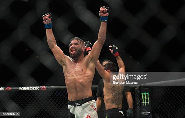 Jeremy Stephens and Renan Barao raise their hands after their featherweight bout during the UFC Fight Night event inside the Mandalay Bay Events...