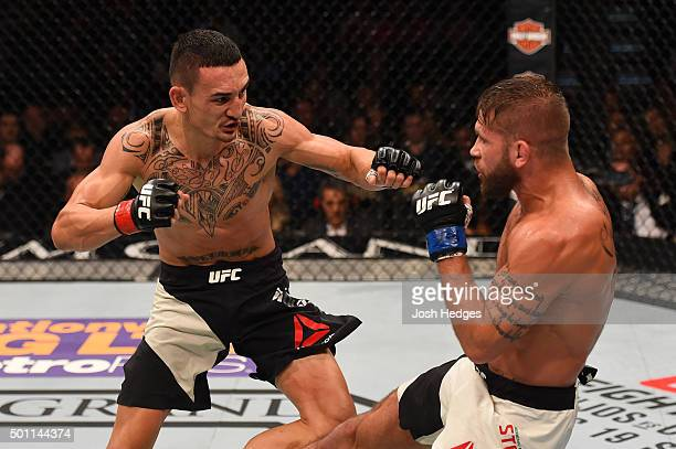 Jeremy Stephens kicks Max Holloway in their featherweight bout during the UFC 194 event inside MGM Grand Garden Arena on December 12 2015 in Las...
