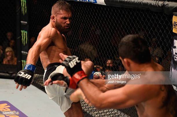 Jeremy Stephens kicks Renan Barao of Brazil in their featherweight bout during the UFC Fight Night event inside the Mandalay Bay Events Center on May...