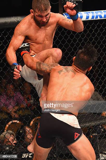 Jeremy Stephens knees Dennis Bermudez in their featherweight fight during the UFC 189 event inside MGM Grand Garden Arena on July 11 2015 in Las...