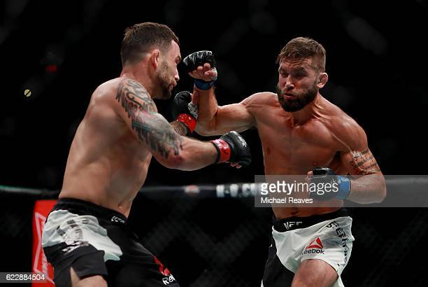 Jeremy Stephens of the United States fights against Frankie Edgar of the United States in their featherweight bout during the UFC 205 event at...