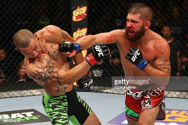 Jeremy Stephens punches Cub Swanson in their featherweight bout at the ATT Center on June 28 2014 in San Antonio Texas