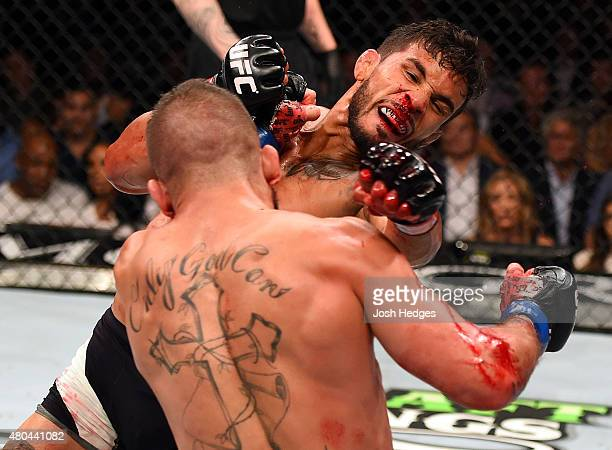 Jeremy Stephens punches Dennis Bermudez in their featherweight fight during the UFC 189 event inside MGM Grand Garden Arena on July 11 2015 in Las...