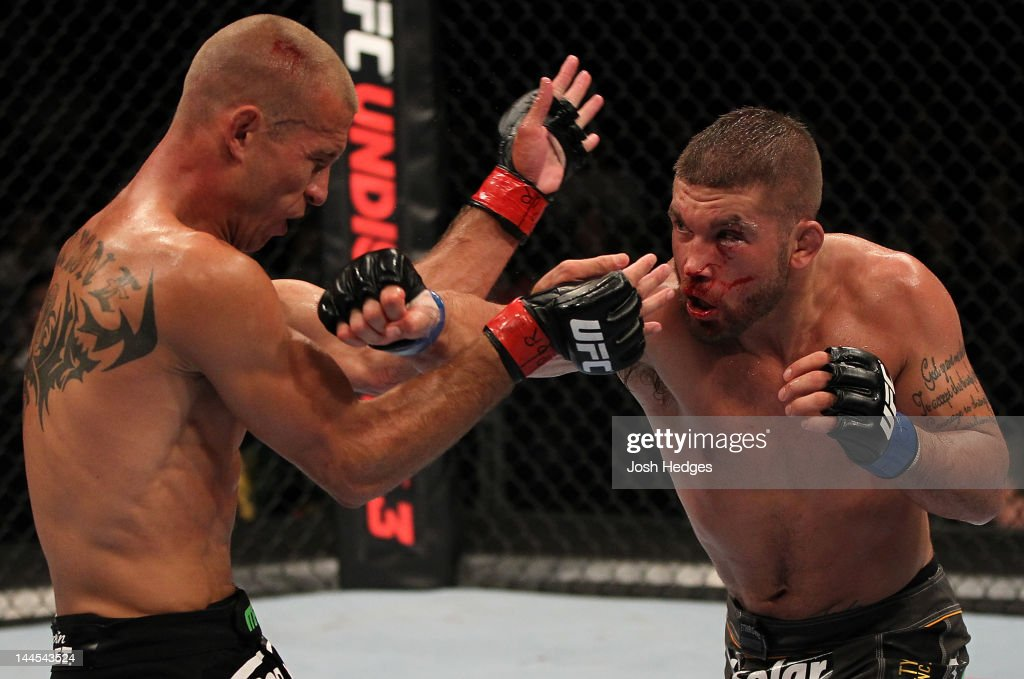 Jeremy Stephens punches Donald 'Cowboy' Cerrone in a lightweight bout during the UFC on Fuel TV event at Patriot Center on May 15, 2012 in Fairfax, Virginia.