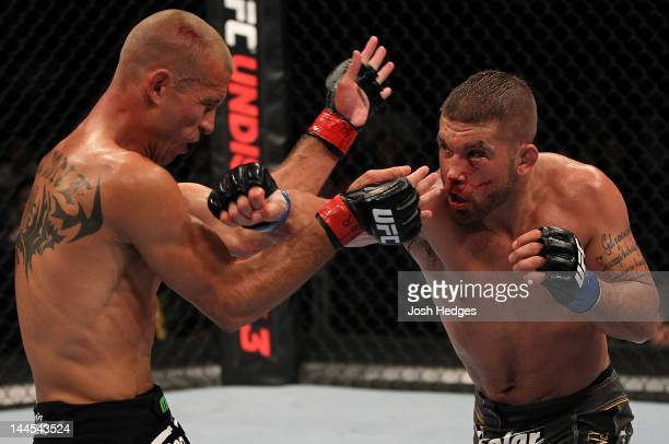 Jeremy Stephens punches Donald 'Cowboy' Cerrone in a lightweight bout during the UFC on Fuel TV event at Patriot Center on May 15 2012 in Fairfax...