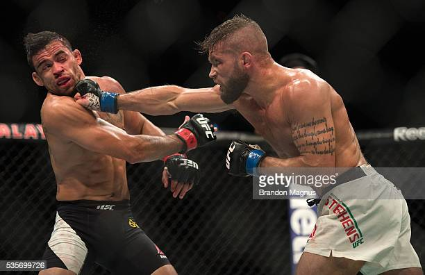 Jeremy Stephens punches Renan Barao in their featherweight bout during the UFC Fight Night event inside the Mandalay Bay Events Center on May 29 2016...