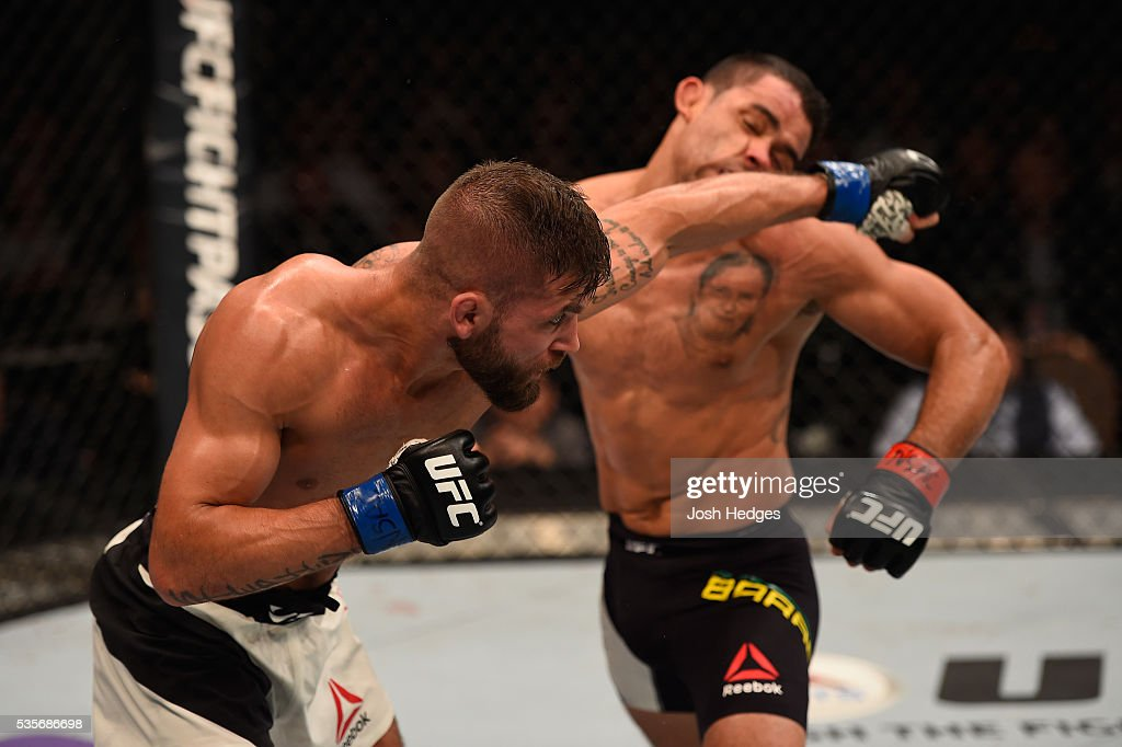 Jeremy Stephens punches Renan Barao of Brazil in their featherweight bout during the UFC Fight Night event inside the Mandalay Bay Events Center on May 29, 2016 in Las Vegas, Nevada.