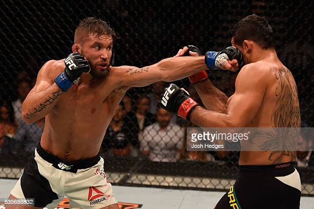 Jeremy Stephens punches Renan Barao of Brazil in their featherweight bout during the UFC Fight Night event inside the Mandalay Bay Events Center on...