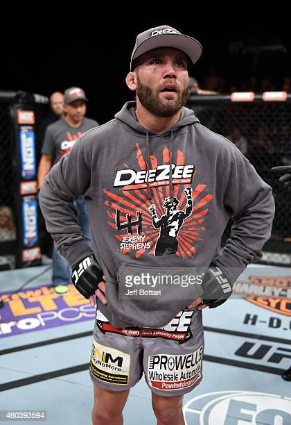 Jeremy Stephens waits to hear the decision after his fight against Charles Oliveira in their lightweight fight during The Ultimate Fighter Finale...