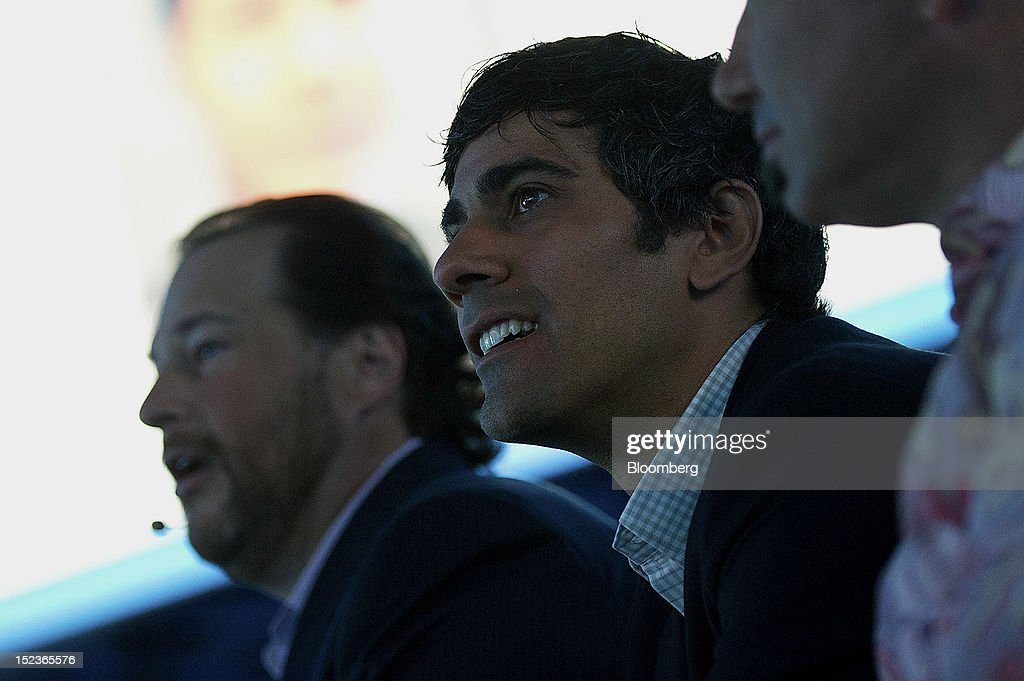Jeremy Stoppelman, chief executive officer of Yelp Inc., right, and Marc Benioff, chairman and chief executive officer of Salesforce.com Inc., watch a presentation during a keynote address at the DreamForce Conference in San Francisco, California, U.S., on Wednesday, Sept. 19, 2012. Salesforce.com Inc. said it's releasing a new version of its software for tablet computers and unifying its social-media marketing products into a single suite, as it races to stay ahead of new market entrants. Photographer: David Paul Morris/Bloomberg via Getty Images