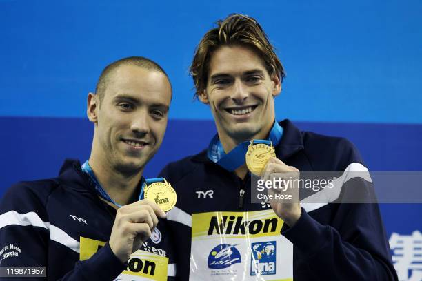 Jeremy Stravius and Camille Lacourt of France celebrate their dead heat gold medal in the Men's 100m Backstroke Final during Day Eleven of the 14th...