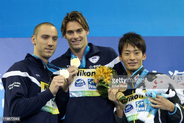 Jeremy Stravius and Camille Lacourt of France celebrate their dead heat gold medal with bronze medalist Ryosuke Irie of Japan in the Men's 100m...