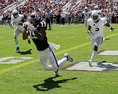 Jeremy Tabuyo of the Texas AM Aggies scores on a reception in the third quarter as he beats LJ Jackson of the Nevada Wolf Pack and Kaodi Dike on he...