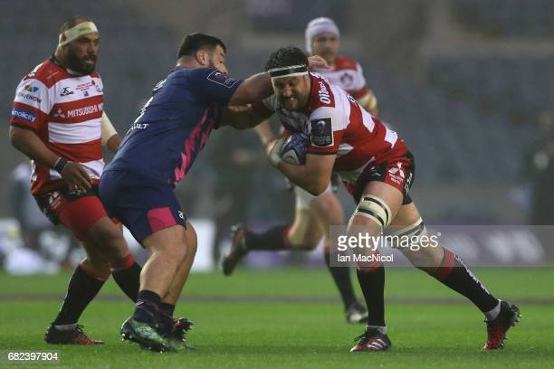 Jeremy Thrush of Gloucester charges into Rabah Slimani of Stade Francais during the European Rugby Challenge Cup Final between Gloucester and Stade...