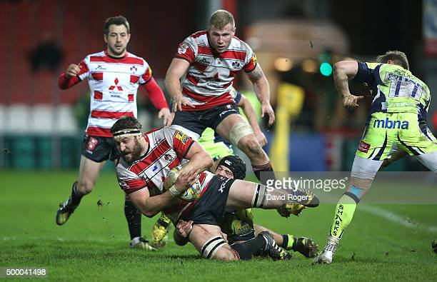 Jeremy Thrush of Gloucester is tackled during the Aviva Premiership match between Gloucester and Sale Sharks at Kingsholm on December 4 2015 in...