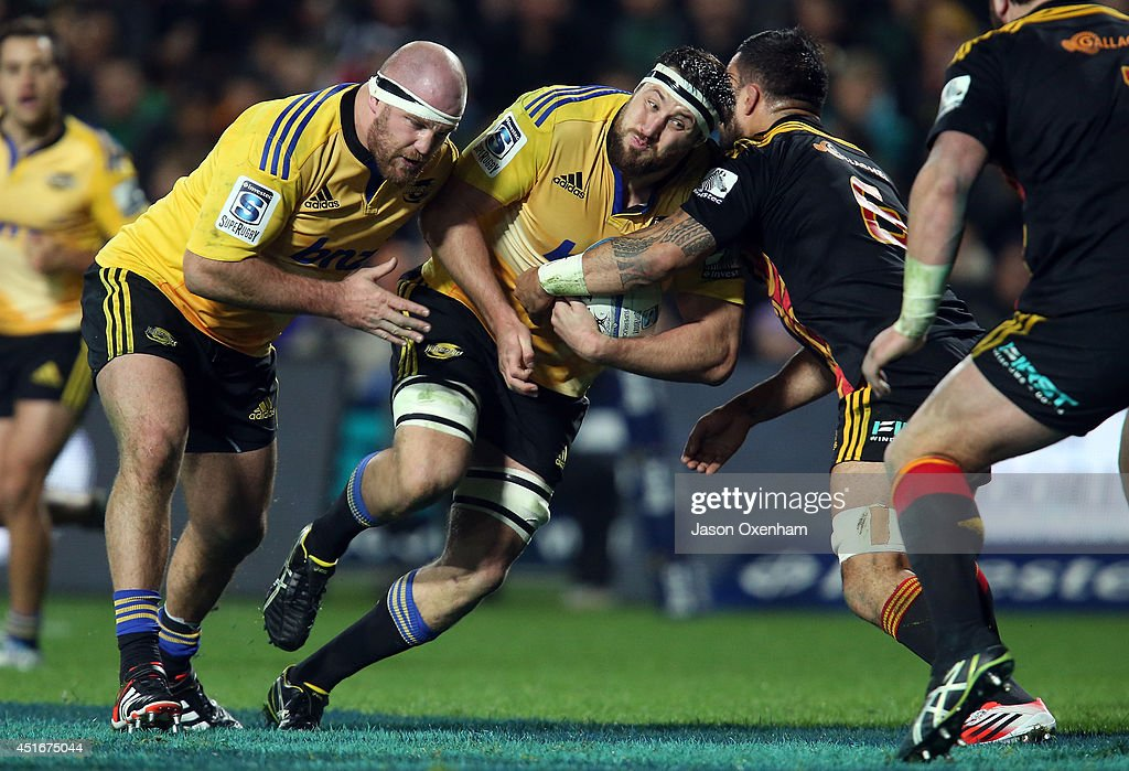 <a gi-track='captionPersonalityLinkClicked' href=/galleries/search?phrase=Jeremy+Thrush&family=editorial&specificpeople=676840 ng-click='$event.stopPropagation()'>Jeremy Thrush</a> of the Hurricanes charges into Liam Messam of the Chiefs with the assistance of <a gi-track='captionPersonalityLinkClicked' href=/galleries/search?phrase=Ben+Franks&family=editorial&specificpeople=3940695 ng-click='$event.stopPropagation()'>Ben Franks</a> (L) of the Hurricanes during the round 18 Super Rugby match between the Chiefs and the Hurricanes at Waikato Stadium on July 4, 2014 in Hamilton, New Zealand.