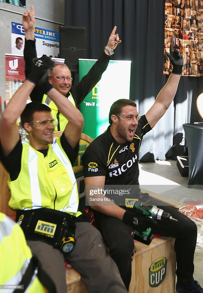 Jeremy Thrush of Wellington (R) and his apprentice Cameron Kanaris celebrate completing the challenge during the 2013 launch of the ITM Cup at Unitec on August 6, 2013 in Auckland, New Zealand.