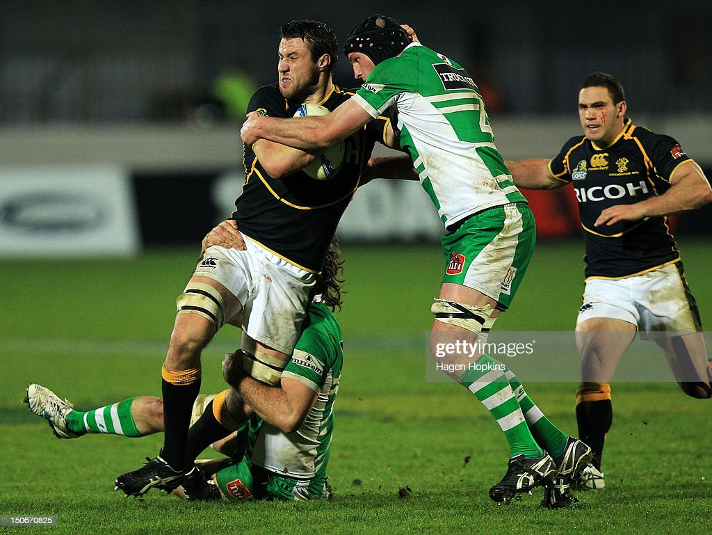 Jeremy Thrush of Wellington is tackled by Fraser Stone of Manawatu during the round one ITM Cup match between Manawatu and Wellington at FMG Stadium on August 24, 2012 in Palmerston North, New Zealand.