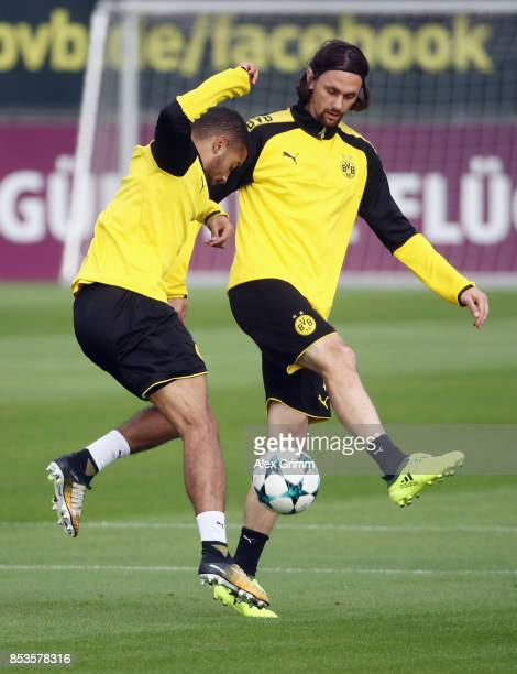 Jeremy Toljan is challenged by Neven Subotic during a Borussia Dortmund training session ahead of their UEFA Champions League Group H match against...
