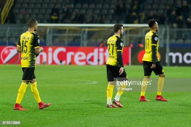 Jeremy Toljan of Borussia Dortmund Gonzalo Castro of Borussia Dortmund and Auba PierreEmerick Aubameyang of Borussia Dortmund look dejected during...