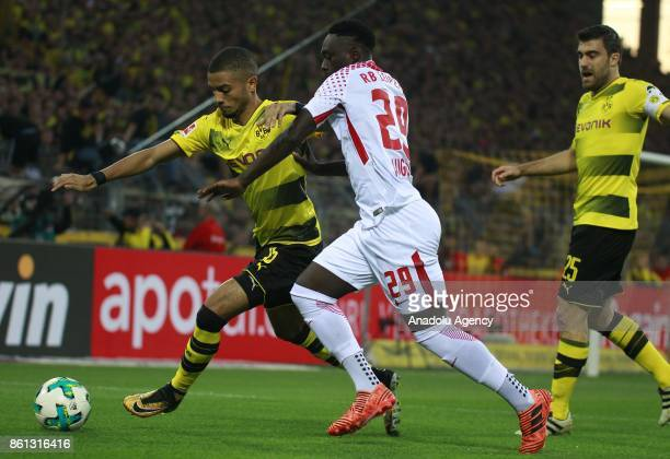 Jeremy Toljan of Borussia Dortmund in action against JeanKevin Augustin of Rasenballsport Leipzig during the Bundesliga soccer match between Borussia...
