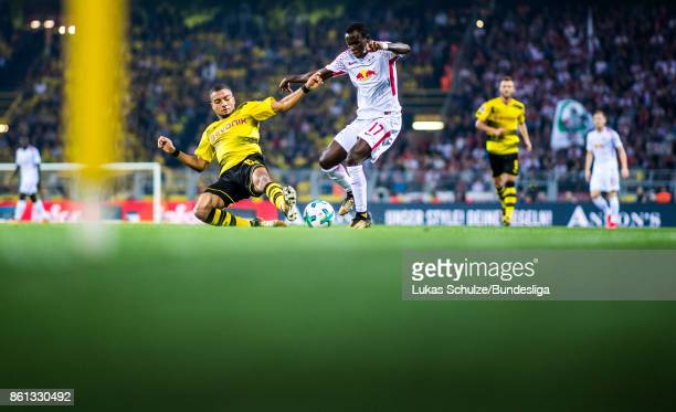 Jeremy Toljan of Dortmund and Bruma of Leipzig fight for the ball during the Bundesliga match between Borussia Dortmund and RB Leipzig at Signal...