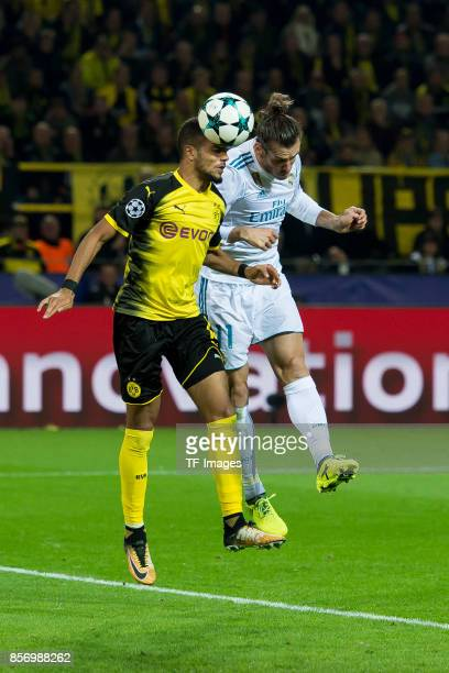 Jeremy Toljan of Dortmund and Gareth Bale of Real Madrid battle for the ball during the UEFA Champions League group H match between Borussia Dortmund...
